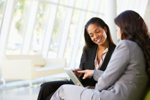 bigstock-Businesswomen-With-Digital-Tab-42381265
