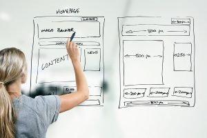 bigstock-Designer-Drawing-Website-Devel-50658908
