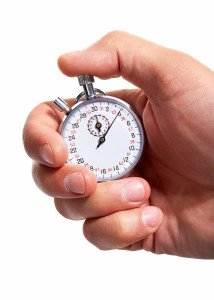 bigstock-Hand-with-a-stopwatch-Isolate-50035106